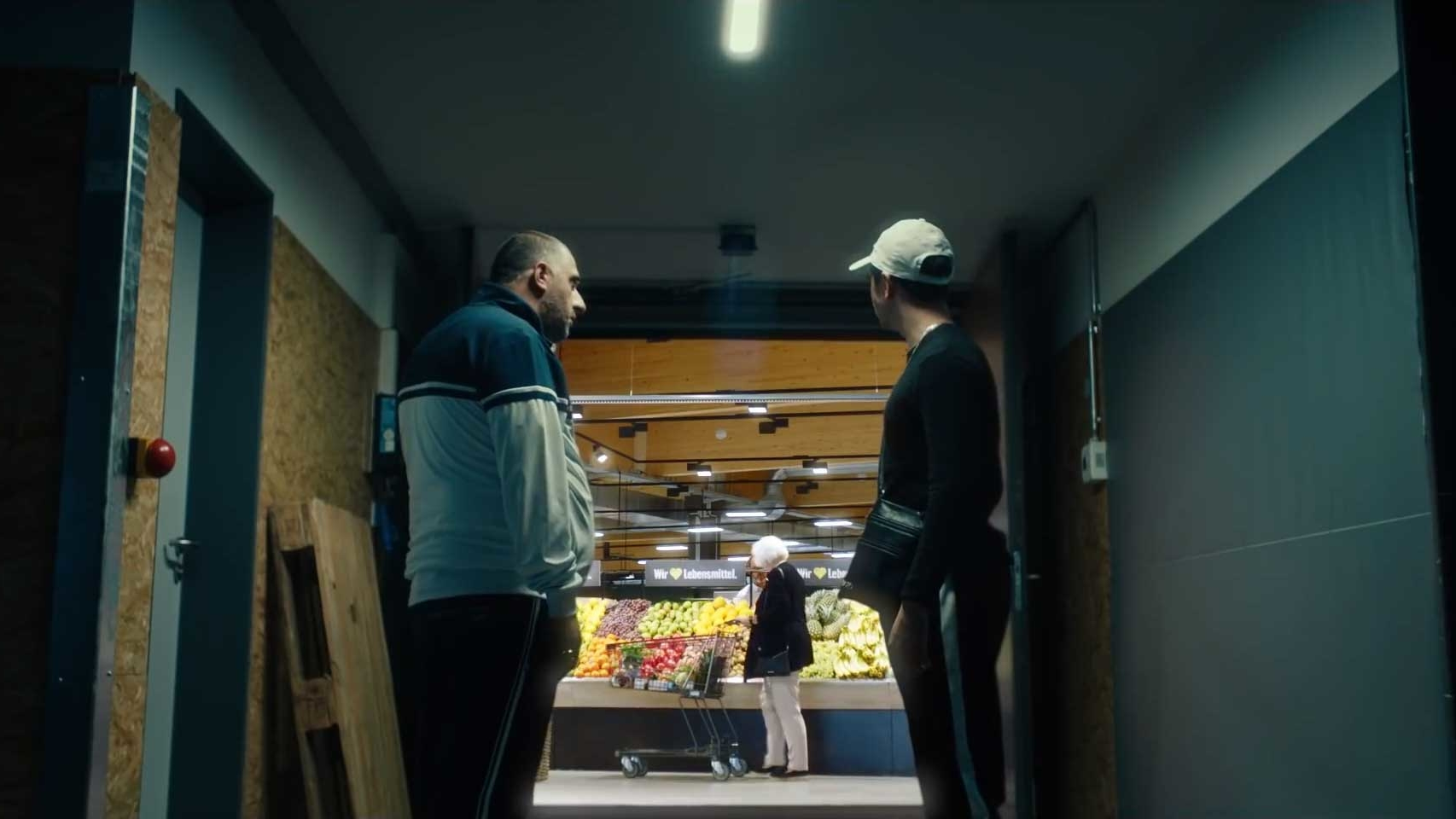 two men looking in a supermarket