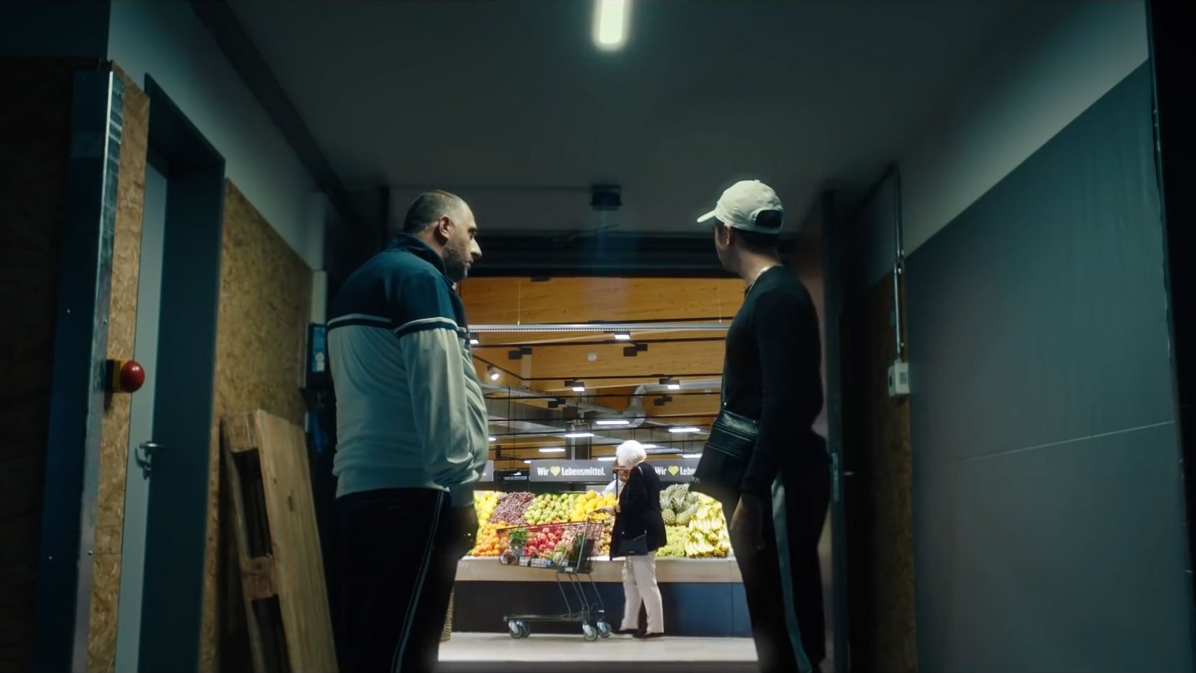 Two men looking into a Supermarket